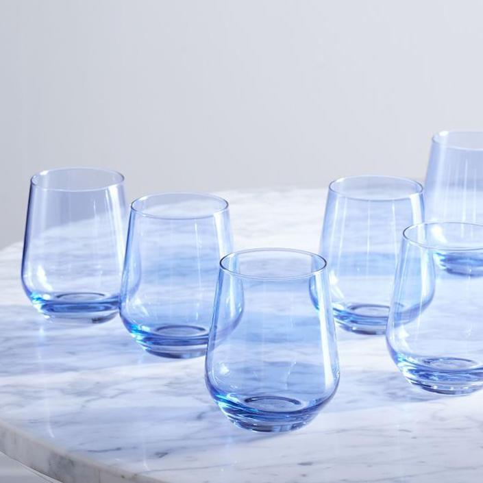 "We at Clever are big fans of Stephanie Hall's <a href=""https://www.architecturaldigest.com/story/the-pastel-glassware-you-need-this-summer?mbid=synd_yahoo_rss"" rel=""nofollow noopener"" target=""_blank"" data-ylk=""slk:pastel-hued glassware"" class=""link rapid-noclick-resp"">pastel-hued glassware</a>. These stemless wine glasses are multifunctional and you can choose from six stunning colors for your heirloom-worthy set. $160, West Elm. <a href=""https://www.westelm.com/products/lcl-estelle-colored-glass-stemware-d11089/?_br_psugg_q=estelle+colored+glass"" rel=""nofollow noopener"" target=""_blank"" data-ylk=""slk:Get it now!"" class=""link rapid-noclick-resp"">Get it now!</a>"