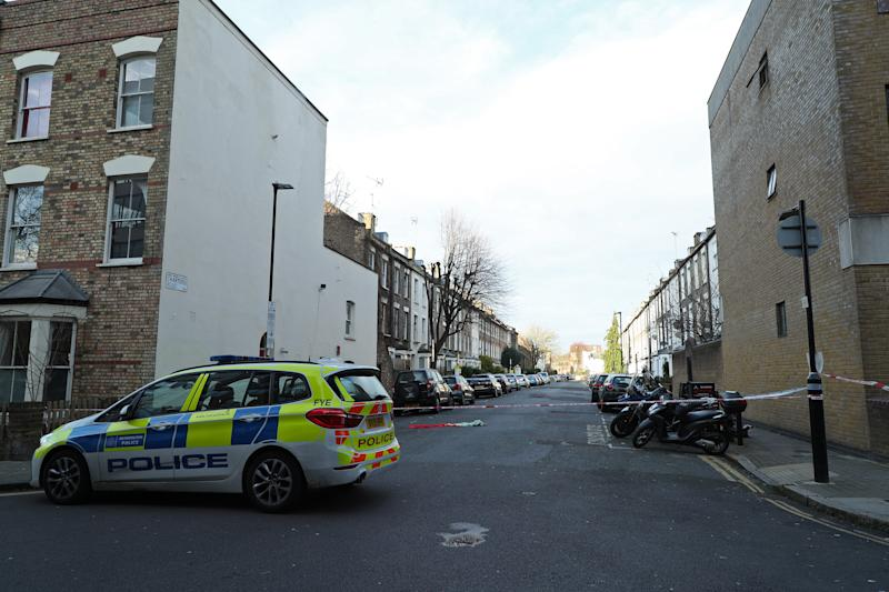 Metropolitan police cordon off Charteris Road close to the junction with Lennox Road in Finsbury Park in north London, after a man was stabbed to death on Friday evening.