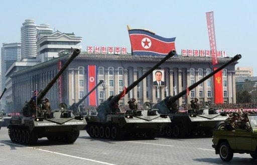 North Korean artillery units are displayed during a military parade in Pyongyang in April 2012. North Korea's new constitution proclaims its status as a nuclear-armed nation, complicating international efforts to persuade Pyongyang to abandon atomic weapons, analysts said Thursday