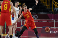 Spain's Laura Gil (24) loses control of the ball during women's basketball preliminary round game at the 2020 Summer Olympics, Monday, July 26, 2021, in Saitama, Japan. (AP Photo/Charlie Neibergall)