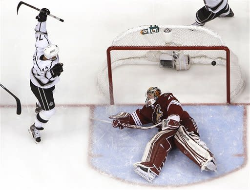 Los Angeles Kings' Dwight King (74) celebrates his goal against Phoenix Coyotes' Mike Smith during the second period of Game 1 of the NHL hockey Stanley Cup Western Conference finals, Sunday, May 13, 2012, in Glendale, Ariz. The Kings defeated the Coyotes 4-2.(AP Photo/Ross D. Franklin)