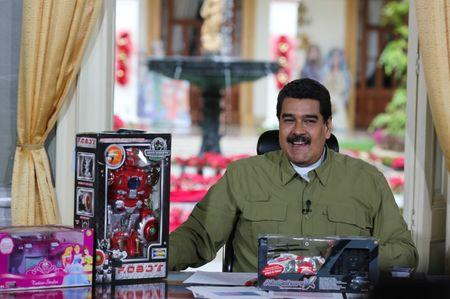 """Venezuela's President Nicolas Maduro speaks next to children toys during his weekly broadcast """"En contacto con Maduro"""" (In contact with Maduro) at Miraflores Palace in Caracas"""