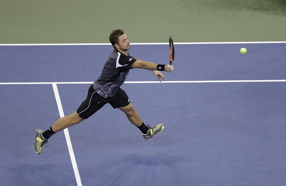 Stan Wawrinka, of Switzerland, returns a shot to Thomaz Bellucci, of Brazil, during the second round of the U.S. Open tennis tournament Wednesday, Aug. 27, 2014, in New York. (AP Photo/Darron Cummings)