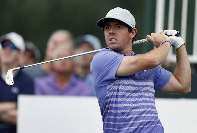 Rory McIlroy, of Northern Ireland, tees off on the eighth hole during the first round of the BMW Championship golf tournament at Cherry Hills Country Club in Cherry Hills Village, Colo., Thursday, Sept. 4, 2014. (AP Photo/Brennan Linsley)