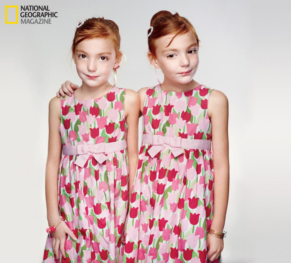 ©Martin Schoeller/National Geographic Six-year-old Johanna Gill puts a protective hand on her sister, Eva. The twins both have mild autism, a disorder linked to genetic inheritance.