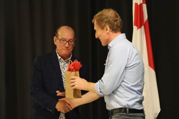 Chief Terry Paul gives a gift to Marc Miller at the announcement.  (Erin Pottie/CBC - image credit)