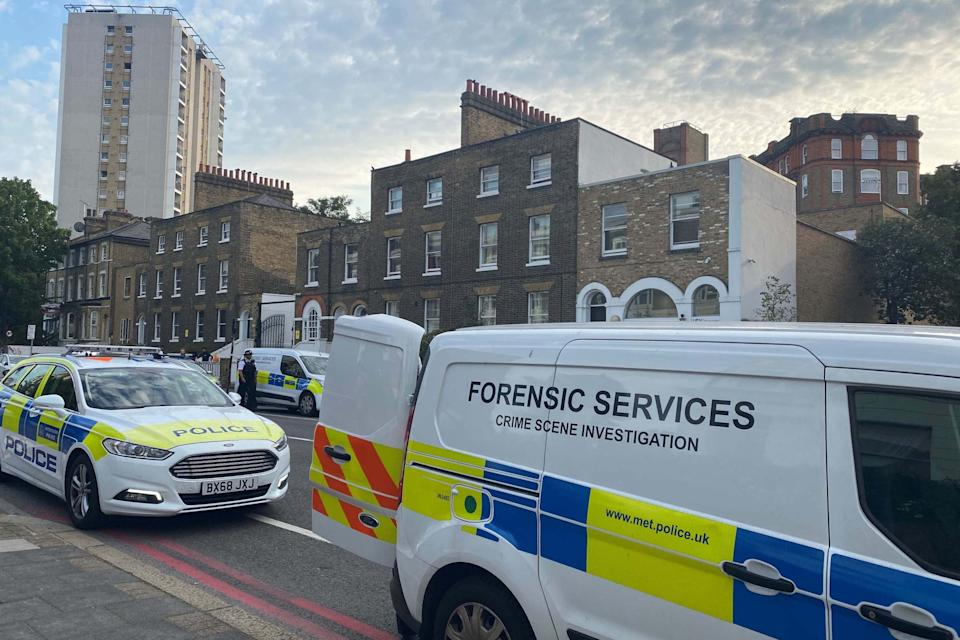 Police at the scene in Stockwell Road, Lambeth (PA)