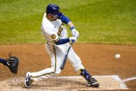 Milwaukee Brewers' Manny Pina hits a two-run home run during the sixth inning of a baseball game against the Minnesota Twins Tuesday, Aug. 11, 2020, in Milwaukee. (AP Photo/Morry Gash)