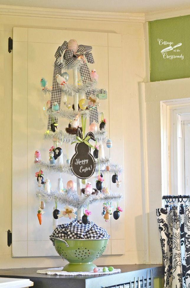 """<p>Pops of black are unexpected for Easter but play surprisingly well with other pastels against a white tree. Can't find a white tree? Spray paint one like they did here. </p><p><strong>Get the tutorial at <a href=""""https://cottageatthecrossroads.com/easter-tree-kitchen/"""" rel=""""nofollow noopener"""" target=""""_blank"""" data-ylk=""""slk:Cottage At The Crossroads"""" class=""""link rapid-noclick-resp"""">Cottage At The Crossroads</a>.</strong></p><p><strong><a class=""""link rapid-noclick-resp"""" href=""""https://go.redirectingat.com?id=74968X1596630&url=https%3A%2F%2Fwww.wayfair.com%2Fholiday-decor%2Fpdp%2Fthe-holiday-aisle-2-snow-white-pine-artificial-christmas-tree-with-50-multi-colored-lights-with-stand-w000112936.html&sref=https%3A%2F%2Fwww.countryliving.com%2Fdiy-crafts%2Fg26498744%2Feaster-tree%2F"""" rel=""""nofollow noopener"""" target=""""_blank"""" data-ylk=""""slk:SHOP WHITE TREES"""">SHOP WHITE TREES</a><br></strong></p>"""
