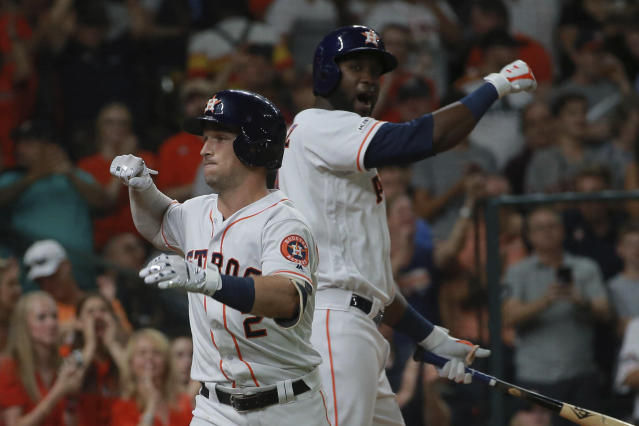 Houston Astros' Alex Bregman, left, celebrates his two-run home run off Detroit Tigers pitcher Jordan Zimmerman with on-deck batter Yordan Alvarez in the fourth inning of a baseball game Thursday, Aug. 22, 2019, in Houston. (AP Photo/Richard Carson)