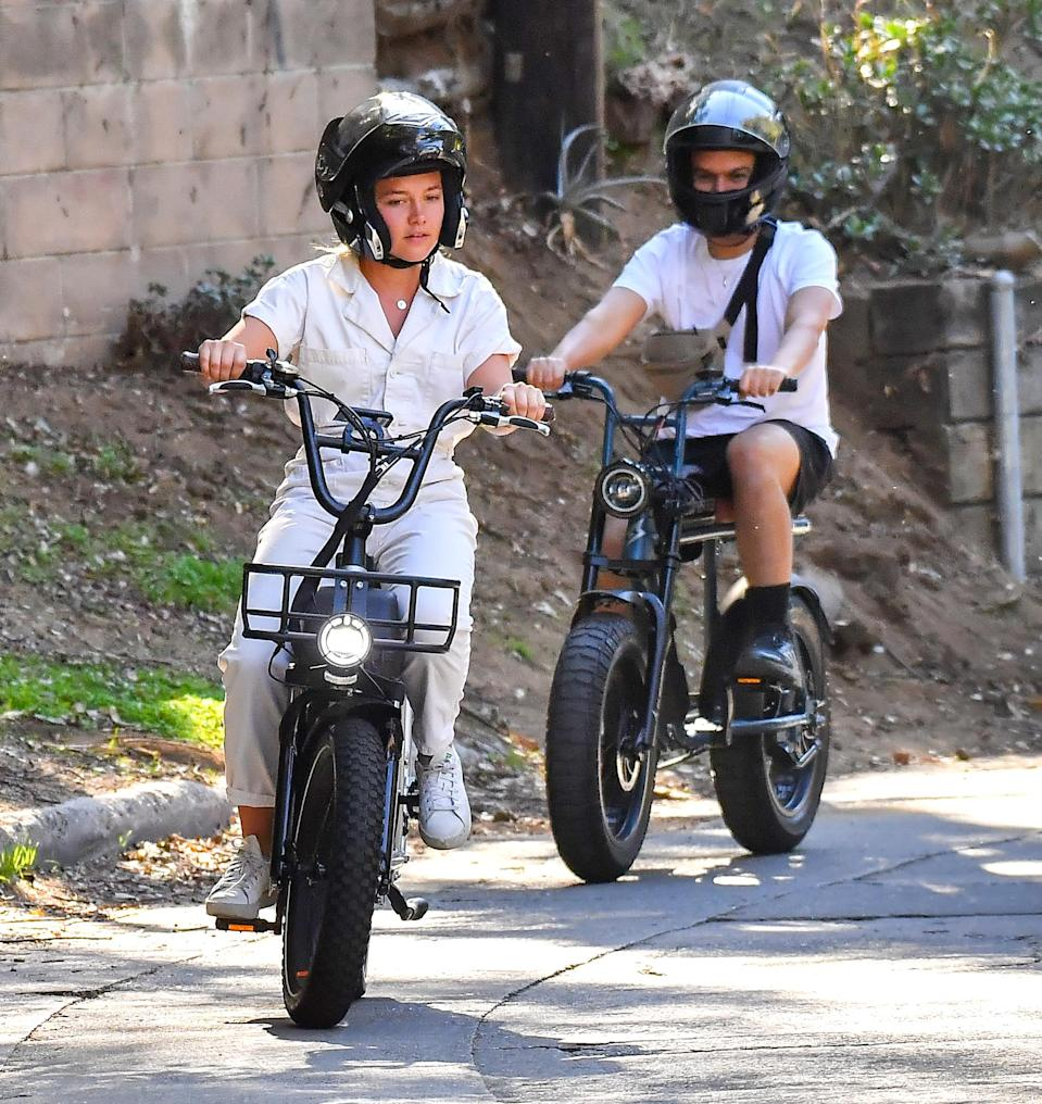 <p>Florence Pugh was spotted riding a fun electric bike with a friend in a Los Angeles neighborhood.</p>