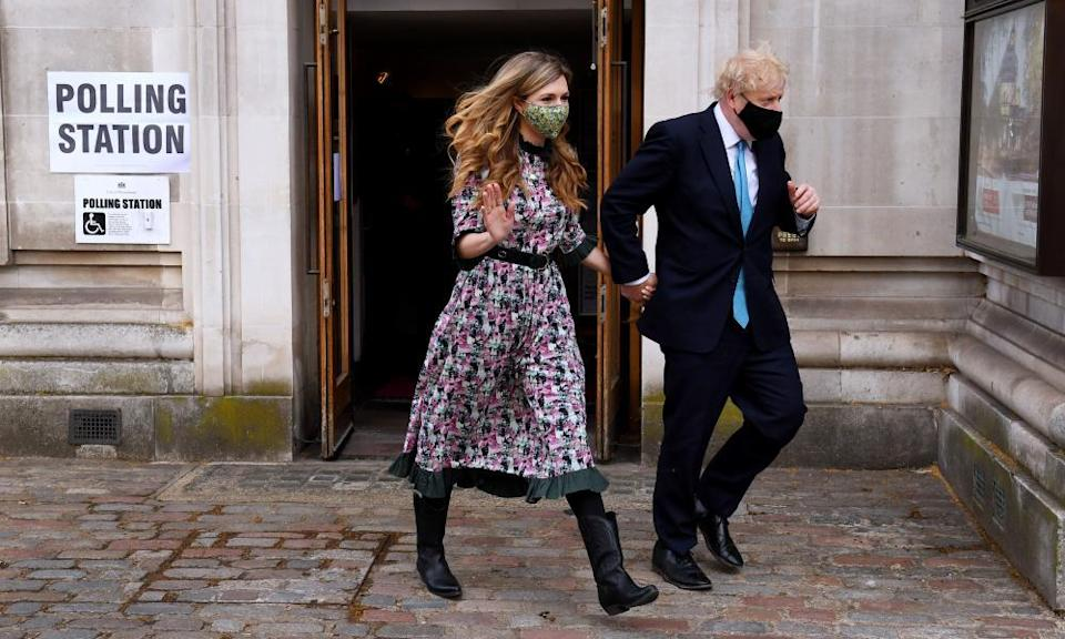 Boris Johnson and his partner, Carrie Symonds, visit Methodist Central Hall in Westminster to cast their votes.