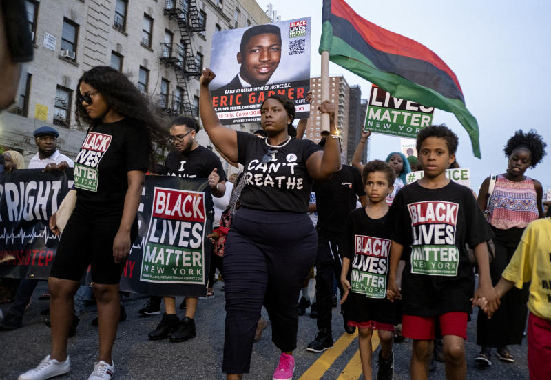 Activists with Black Lives Matter protest in the Harlem neighborhood of New York, Tuesday, July 16, 2019, in the wake of a decision by federal prosecutors who declined to bring civil rights charges against New York City police Officer Daniel Pantaleo, in the 2014 chokehold death of Eric Garner. The decision was made by Attorney General William Barr and announced one day before the five-year anniversary of his death, officials said. (AP Photo/Craig Ruttle)