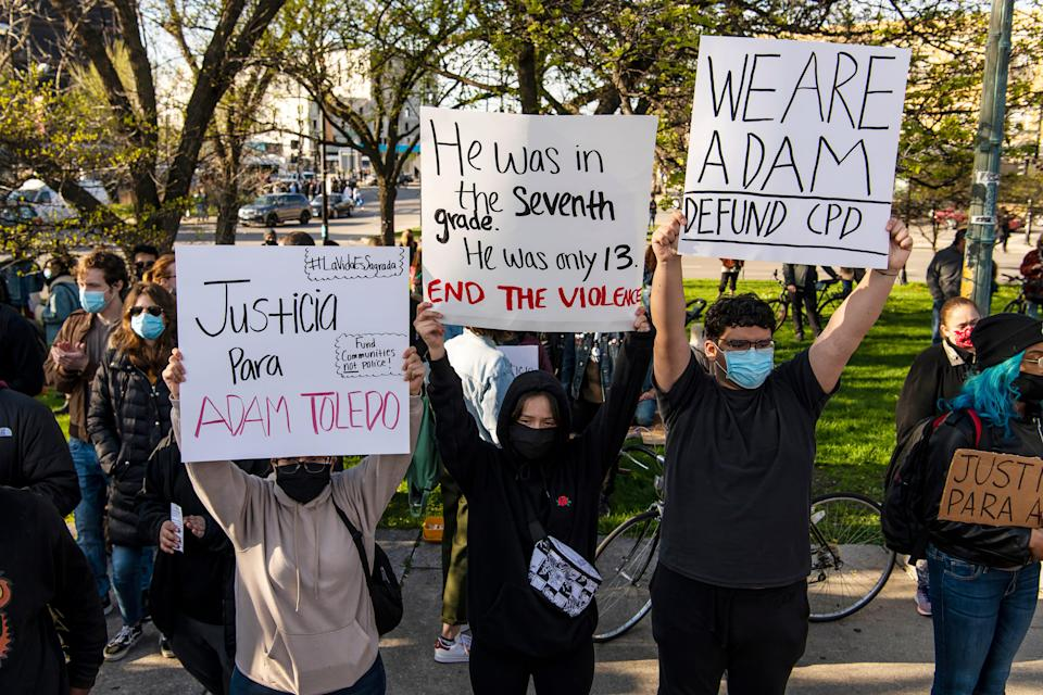 Activists protest near Mayor Lori Lightfoot's home in Chicago after the release of body camera footage that showed a police officer fatally shooting Adam Toledo, 13, in late March.