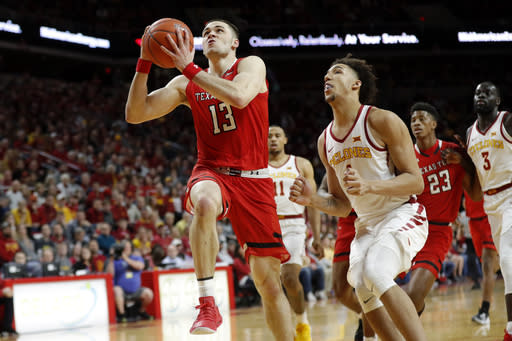 Texas Tech guard Matt Mooney (13) drives to the basket ahead of Iowa State forward George Conditt IV during the first half of an NCAA college basketball game, Saturday, March 9, 2019, in Ames, Iowa. (AP Photo/Charlie Neibergall)