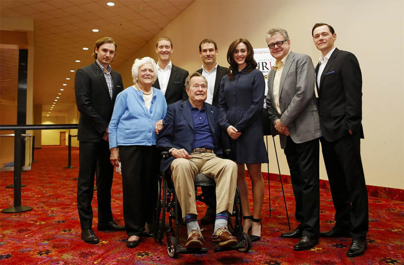 George H.W. Bush and wife Barbara pose with Lind and the case of AMC's