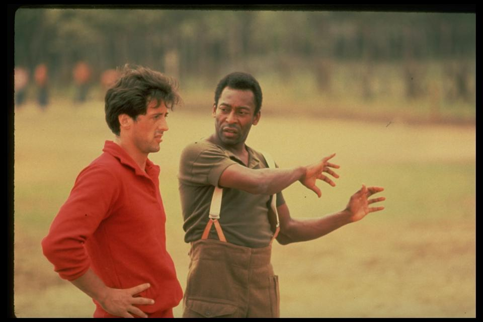 (L-R) Actor Sylvester Stallone getting pointers fr. soccer great Pele during filming of motion picture Escape to Victory.  (Photo by John Bryson/The LIFE Images Collection via Getty Images/Getty Images)