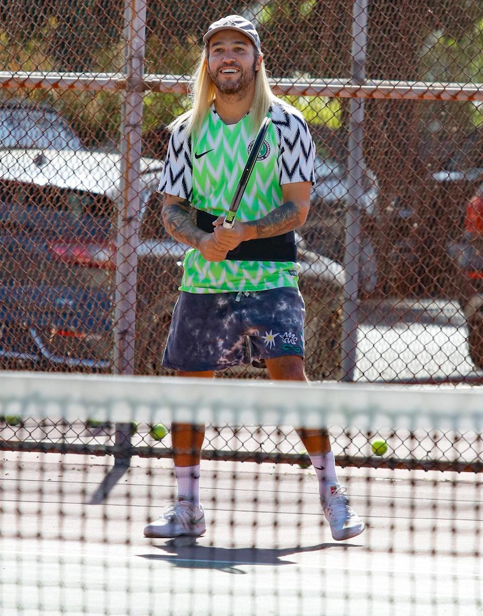 <p>Pete Wentz is all smiles while playing tennis with friends at a local park on Wednesday in L.A. </p>