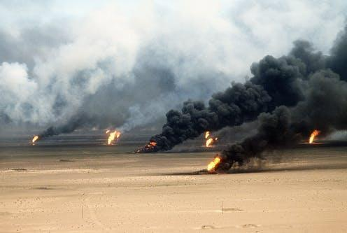 "<span class=""caption"">Oil well fires burning outside of Kuwait.</span> <span class=""attribution""><a class=""link rapid-noclick-resp"" href=""https://www.shutterstock.com/image-photo/oil-well-fires-rage-outside-kuwait-244390672"" rel=""nofollow noopener"" target=""_blank"" data-ylk=""slk:Everett Collection/ Shutterstock"">Everett Collection/ Shutterstock</a></span>"