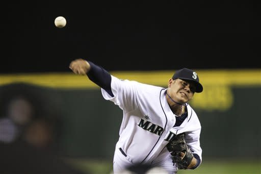 Seattle Mariners starting pitcher Felix Hernandez throws against the Baltimore Orioles in the first inning of a baseball game, Wednesday, Sept. 19, 2012, in Seattle. (AP Photo/Ted S. Warren)