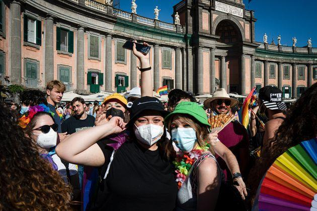 NAPOLI, CAMPANIA, ITALY - 2021/07/03: Girls with make up and accessories with rainbow's color seen in the square. After 25 years since the first event, Napoli Pride was organized in Piazza Dante, in the historical center, for promoting the rights of LGBTQI+ people, with the slogan 'Jesce Sole' (come out sun!). Among the organizers there are several institutions and associations for the LGBTQI+ communitys rights. Among the speakers on the stage there were:  Alessandro Zan, a member of the Democratic Party (Partito Democratico), who proposed the homonymous bill to protect discriminatory acts based on sex and gender; the mayor of Naples, Luigi De Magistris; singers Arisa and Paola Turci and writer and politician Vladimir Luxuria. Cola-Cola, Burger King and Deliveroo figure among the sponsor of the event. (Photo by Valeria Ferraro/SOPA Images/LightRocket via Getty Images) (Photo: SOPA Images via Getty Images)