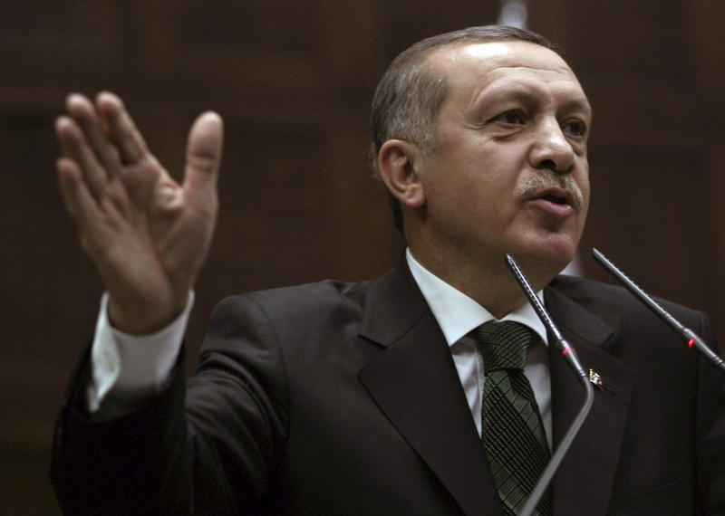 """Turkish Prime Minister Recep Tayyip Erdogan addresses the legislators of his ruling party in parliament in Ankara, Turkey, Tuesday, Oct. 9, 2012. Erdogan said Turkey was prepared to counter any threats from Syria. """"Every kind of threat to the Turkish territory and the Turkish people will find us standing against it,"""" Erdogan said.(AP Photo)"""