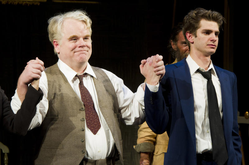 """FILE - In this March 15, 2012 file photo, actors Philip Seymour Hoffman, left, and Andrew Garfield appear at the curtain call for the opening night performance of the Broadway revival of Arthur Miller's """"Death of A Salesman"""" in New York. The Tony Awards will be held on June 10 and broadcast live on CBS. (AP Photo/Charles Sykes, file)"""