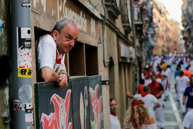 PAMPLONA, SPAIN - JULY 08: A man watches the Dolores Aguirre's ranch fighting bulls running at Curva Estafeta during the third day of the San Fermin Running Of The Bulls festival, on July 8, 2013 in Pamplona, Spain. The annual Fiesta de San Fermin, made famous by the 1926 novel of US writer Ernest Hemmingway 'The Sun Also Rises', involves the running of the bulls through the historic heart of Pamplona for nine days from July 6-14. (Photo by Pablo Blazquez Dominguez/Getty Images)