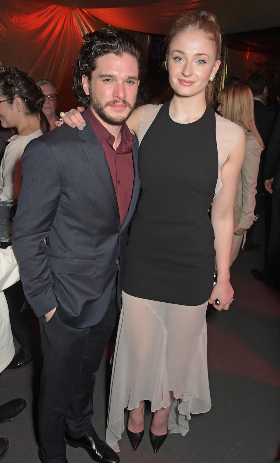 LONDON, ENGLAND - MARCH 18:  Kit Harington (L) and Sophie Turner attend the