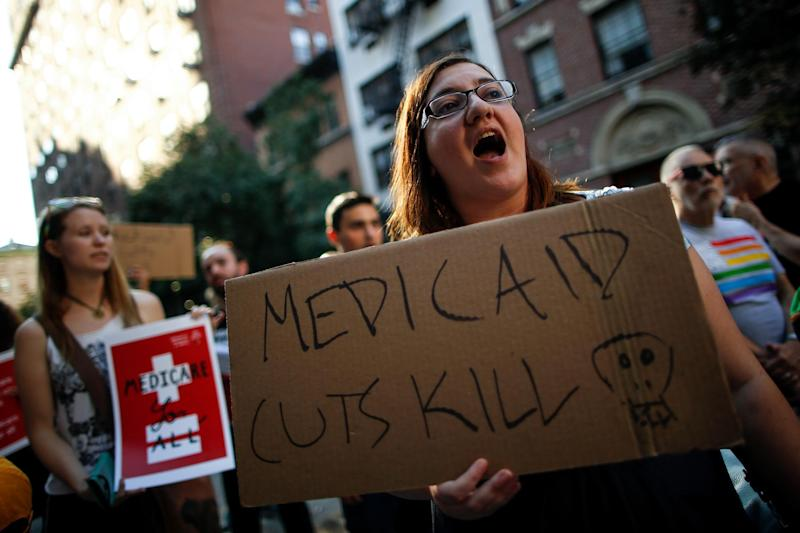 A small group of activists rally against the GOP health care plan outside of the Metropolitan Republican Club in New York: Getty