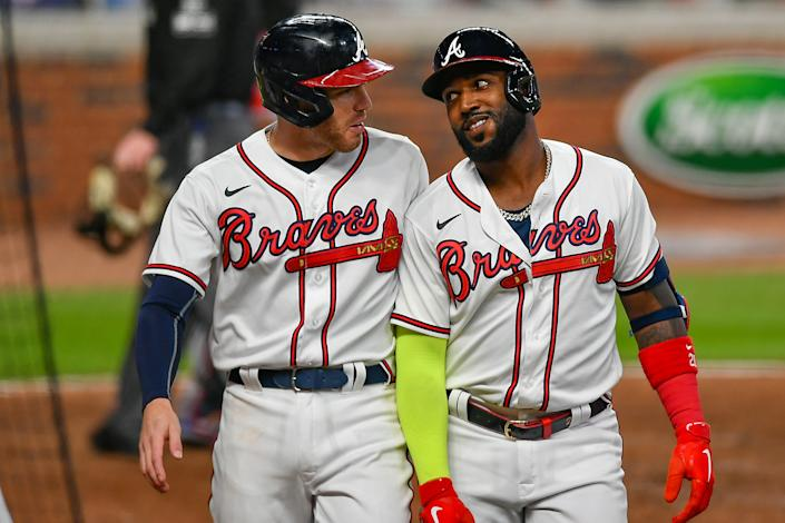 After starring with the Braves last year, Marcell Ozuna (right) is a free agent whose market would likely be affected by the universal DH rule remaining in place.