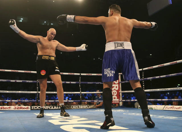 Britain's Tyson Fury, left, and Sefer Seferi gesture to one another during their heavyweight bout at the Manchester Arena, in Manchester, England, Saturday June 9, 2018. (Nick Potts/ PA via AP)