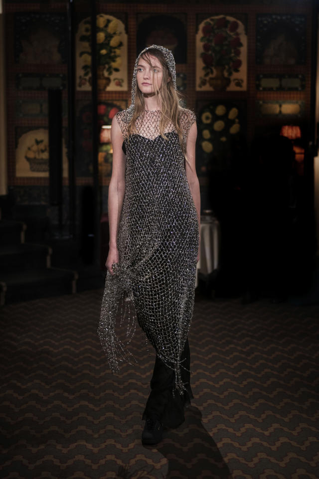 <p><i>Model wears a beaded crystal overlay with hood over a black dress from the SS18 The Row collection. (Photo: ImaxTree) </i></p>