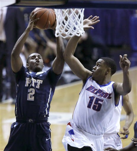 Pittsburgh guard Isaiah Epps (2) shoots and scores past the defense of DePaul forward Moses Morgan during the first half of a Big East NCAA college basketball game on Thursday, Jan. 5, 2012, in Rosemont, Ill. (AP Photo/Charles Rex Arbogast)