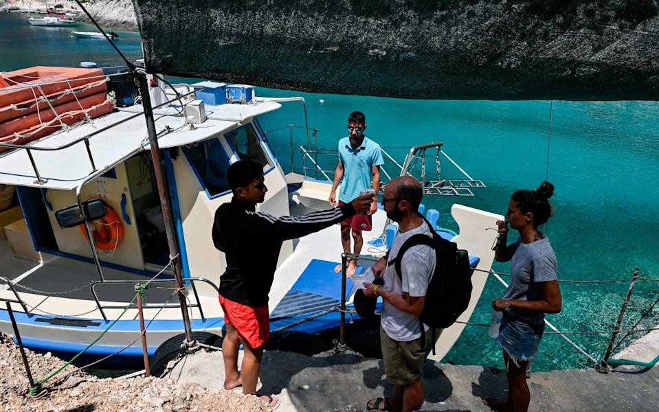 Greece has reopened to international tourists, with new coronavirus measures introduced - AFP