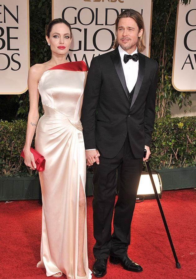 At the 2012 Golden Globes with now-estranged wife Angelina Jolie. Source: Getty