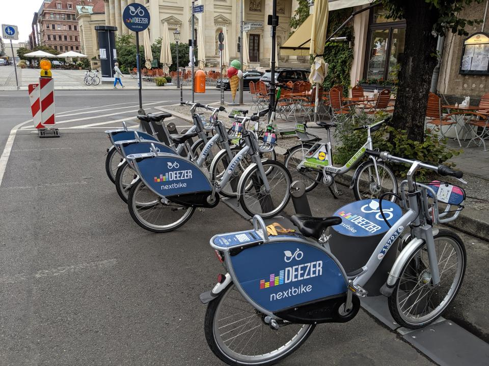 Deezer bikes, Lidl bikes, and a Lime scooter in the Mitte neighborhood. (Yahoo Finance)
