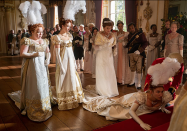 "<p>Being presented to the Queen at the start of London's social season is essentially the same thing as high school prom, just during the Regency era. Penelope Featherington stunned in an empire waist evening gown with gold embroidery for her debut. </p><p><a class=""link rapid-noclick-resp"" href=""https://www.netflix.com/title/80232398"" rel=""nofollow noopener"" target=""_blank"" data-ylk=""slk:STREAM NOW"">STREAM NOW</a></p>"
