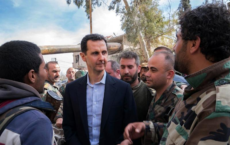 Syrian President Bashar al-Assad talks with government troops in the enclave of Eastern Ghouta, outside Damascus, on March 18, 2018