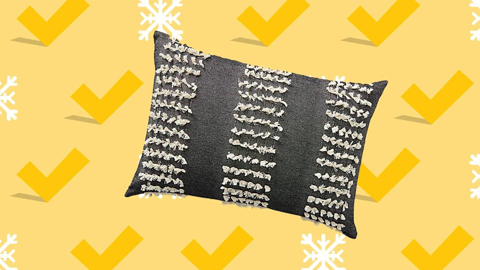 Statement pillows and cozy throws are part of the markdowns at Anthro.