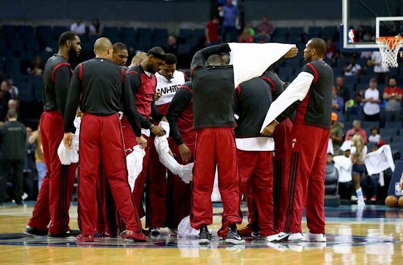 Heat show support for Clippers with silent protest