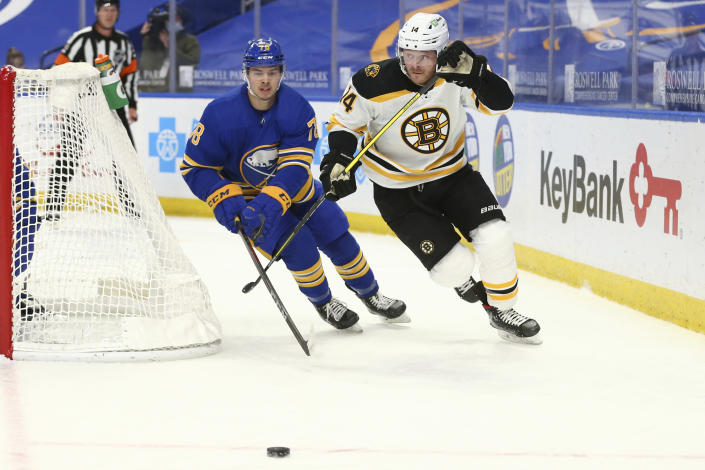 Buffalo Sabres defenseman Jacob Bryson (78) and Boston Bruins forward Chris Wagner (14) race for the puck during the first period of an NHL hockey game, Tuesday, April 20, 2021, in Buffalo, N.Y. (AP Photo/Jeffrey T. Barnes)