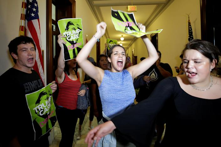 Health care activists protest to stop the Republican health care bill at Russell Senate Office Building on Capitol Hill on July 10, 2017.