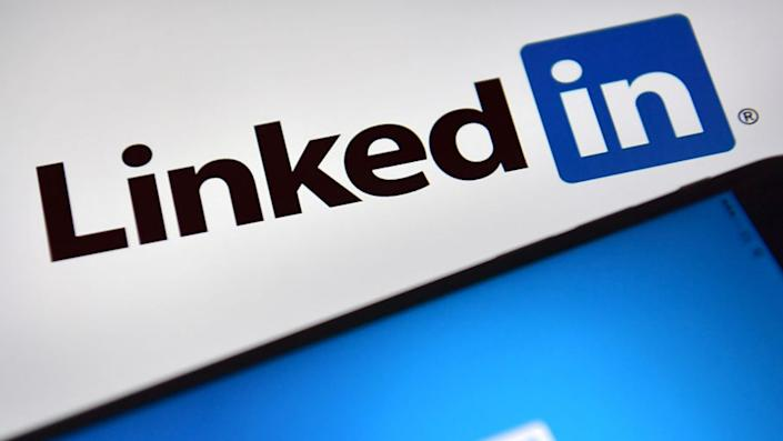 Female users are speaking out after receiving harassing messages from men on LinkedIn. (Image via Getty Images).
