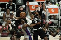Detroit Pistons' Hamidou Diallo, center left, drives to the basket under defense by Los Angeles Clippers' Marcus Morris Sr. during the first half of an NBA basketball game Sunday, April 11, 2021, in Los Angeles. (AP Photo/Jae C. Hong)