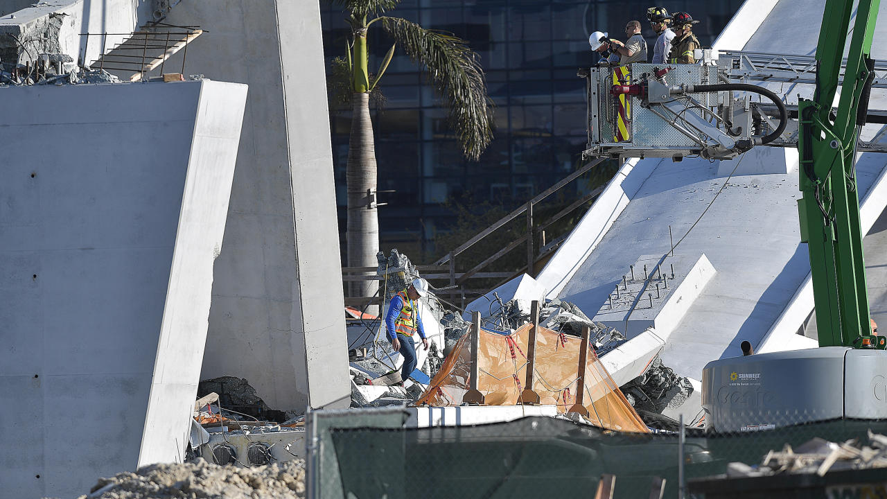 <p>Miam-Dade Fire Rescue personnel work after a brand new, 950-ton pedestrian bridge collapsed in front of Florida International University, March 15, 2018, in Miami. (Photo: Michael Laughlin/South Florida Sun-Sentinel via AP) </p>
