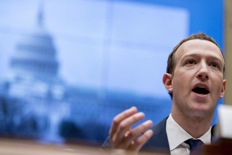 FILE - In this April 11, 2018 file photo, Facebook CEO Mark Zuckerberg testifies before a House Energy and Commerce hearing on Capitol Hill in Washington. Facebook faces a rough road ahead with Libra, but defections by high-profile partners are still unlikely to spell the end for the digital currency. On Friday, Oct. 11, 2019, Visa and MasterCard announced their departures from the Libra project, as did e-commerce giant eBay and payments startup Stripe.  (AP Photo/Andrew Harnik, File)