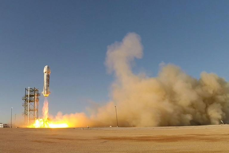This image obtained November 24, 2015 from Bezos's space firm Blue Origin, shows the world's first reusable rocket as it flies from a launch site in West Texas