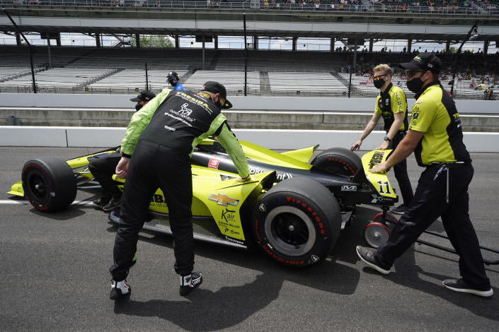 Charlie Kimball, left, touches his car after failing to qualify for the Indianapolis 500 auto race at Indianapolis Motor Speedway, Sunday, May 23, 2021, in Indianapolis. (AP Photo/Darron Cummings)