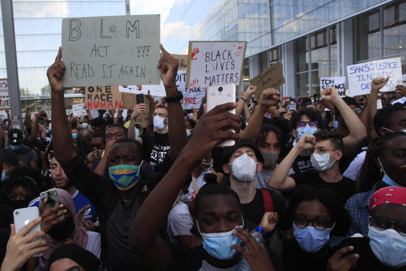 People protest outside the Palace of Justice Tuesday, June 2, 2020 in Paris. French authorities banned the protest over racial injustice and heavy-handed police tactics as global outrage over what happened to George Floyd in the United States kindled frustrations across borders and continents. Family and friends of Adama Traore, a French black man who died shortly after he was arrested by police in 2016, call for a protest which will also pay homage to George Floyd. (AP Photo/Michel Euler)